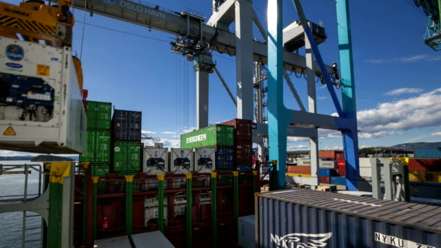 t/l containers being loaded on a ship - container stock videos & royalty-free footage