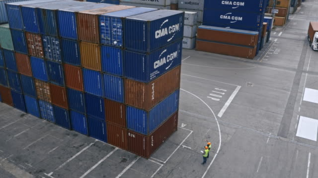 aerial containers being stacked high at the container terminal - physical activity stock videos & royalty-free footage