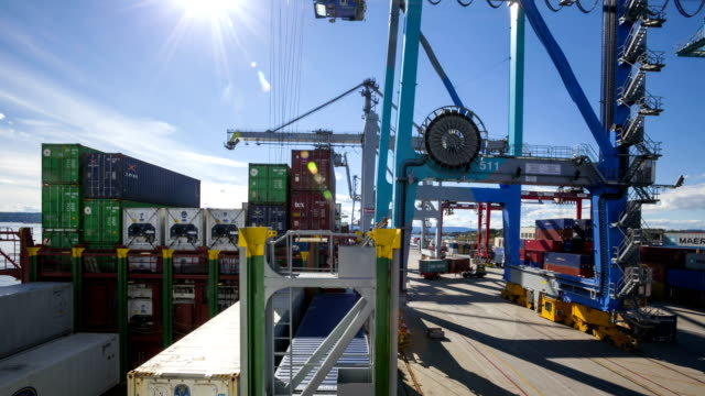 t/l containers being unloaded from a ship - container stock videos & royalty-free footage