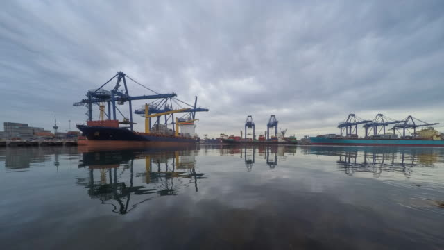 Containers loading by crane at day to night