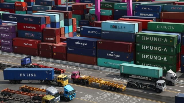 stockvideo's en b-roll-footage met containers sit stacked among gantry cranes at the sun kwang newport container terminal in incheon new port in incheon south korea on monday sept 4... - incheon