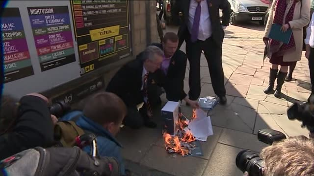 Penrose report published report burned in street SCOTLAND Edinburgh EXT GVs campaigners gathered in street set light to copies of the report papers...