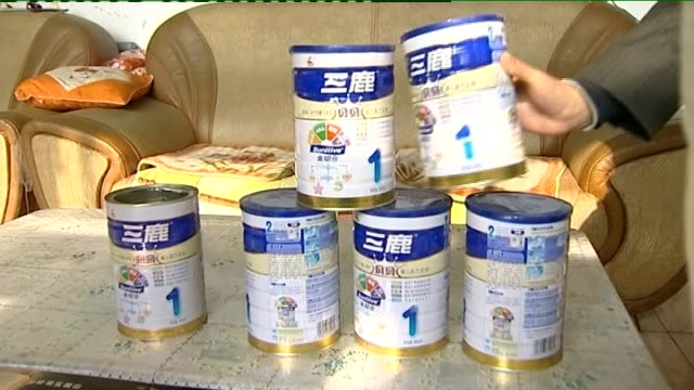 two men sentenced to death various of hou rong bo putting tins of milk powder on table close up of label on milk powder container packets of sanlu... - milk box stock videos & royalty-free footage