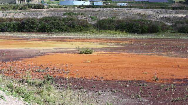 contaminated mine effluent from water draining out of wheal jane, an abandoned tin mine near redruth, cornwall, uk. - tin mine stock videos & royalty-free footage