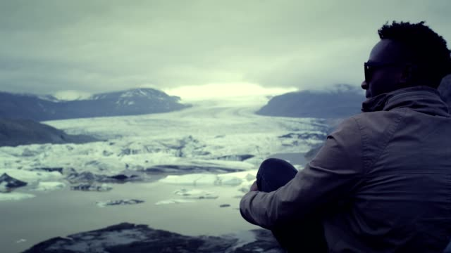 contemplating glacier lagoon - off road car stock videos and b-roll footage