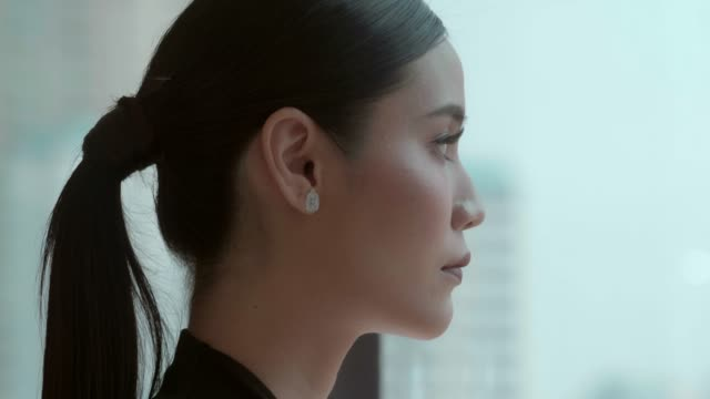 contemplative asian business woman - profile stock videos & royalty-free footage