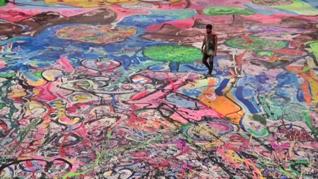 contemporary british artist sacha jafri unveils his giant painting entitled 'the journey of humanity' at a hotel in dubai where he spent months of... - cultures stock videos & royalty-free footage
