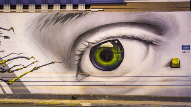 contemporary graffiti in athens city center by graffiti artists ino and aiva - big brother orwellian concept stock videos & royalty-free footage