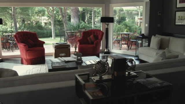 ws ds. pan contemporary living room / punta ala, italy - wide shot stock videos & royalty-free footage