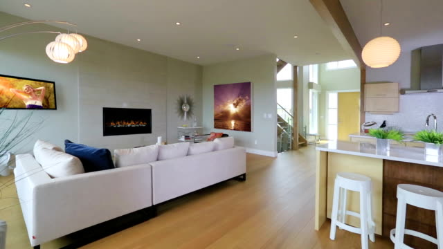 contemporary living room with fireplace - furniture stock videos & royalty-free footage