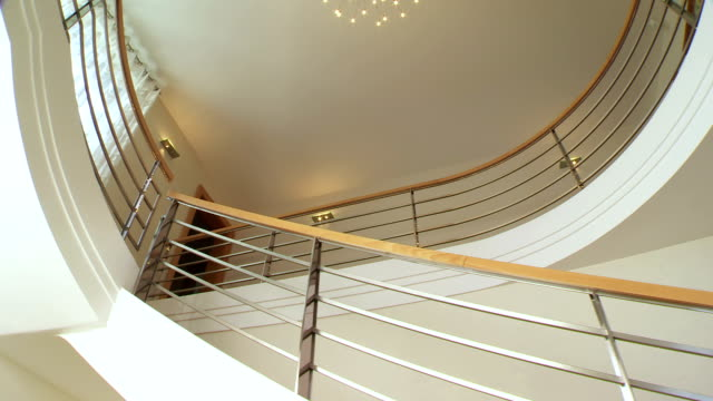 hd crane: contemporary staircase - steps and staircases stock videos & royalty-free footage