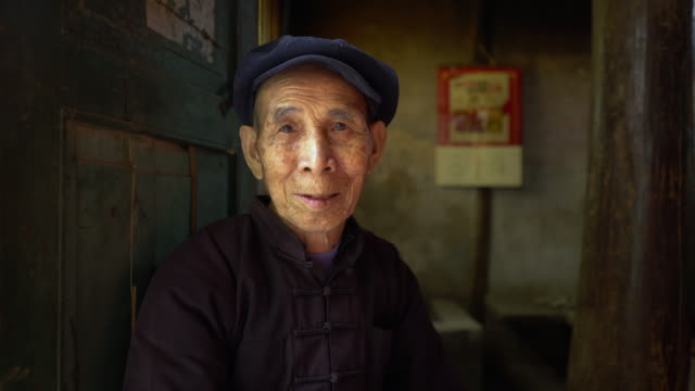 content chinese old man - traditional clothing stock videos & royalty-free footage