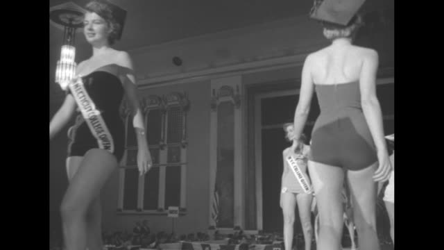 contestant in bathing suit on runway / four shots of contestants in bathing suits walking in line up and down runway / contestants in bathing suits... - contestant stock videos and b-roll footage
