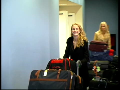 contestants arrive in london; cf tape no longer available itn england: london: gatwick airport: int cms miss world contestant along thru airport mss... - miss world pageant stock videos & royalty-free footage