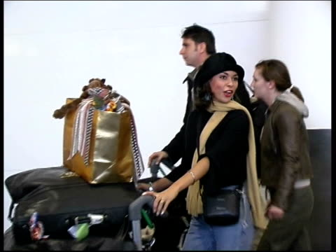 contestants arrive in london; itn england: london: gatwick airport: int gvs miss world contestants along thru airport as arriving in britain after... - ミス・ワールド点の映像素材/bロール