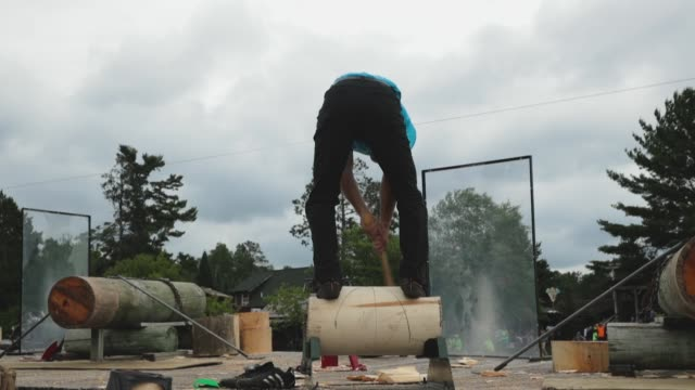 contestants compete in the underhand chopping event at the lumberjack world championships on july 20 2018 in hayward wisconsin - カット切り替え点の映像素材/bロール