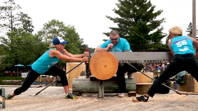 contestants compete in the women's double buck sawing competition at the lumberjack world championships on july 20 2018 in hayward wisconsin - championships stock videos & royalty-free footage