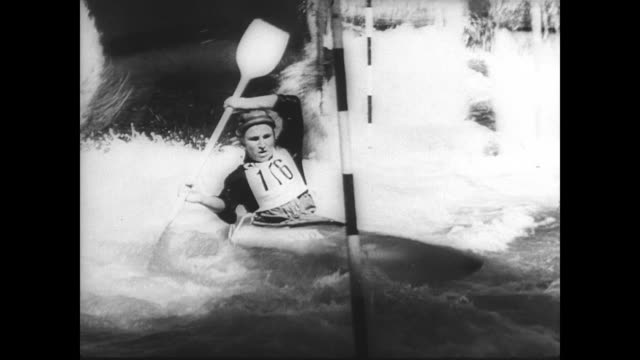 contestants in kayak slalom paddle through the rapids of the ruhr river in germany / kayak overturns / contestants work around the hectic course /... - spielkandidat stock-videos und b-roll-filmmaterial