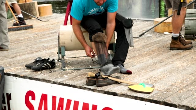 contestants prepare to compete in the underhand chopping event at the lumberjack world championships on july 20 2018 in hayward wisconsin - カット切り替え点の映像素材/bロール