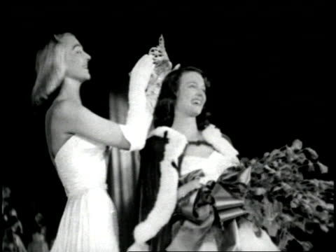 stockvideo's en b-roll-footage met contestants walk across the stage in the 1952 miss american pageant; a mrs. america contestant faints whens she is named the winner. - home economics