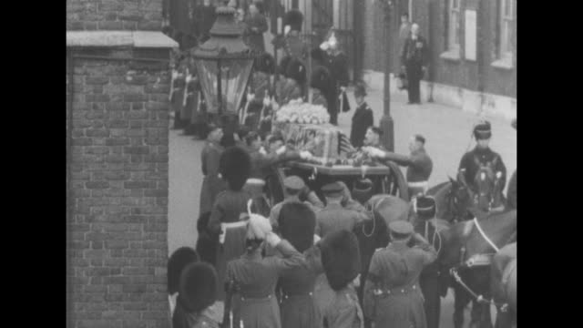 contingent of foot guards escort gun carriage bearing coffin of queen mary as procession to westminster hall moves on london street coffin is draped... - victoria tower stock videos and b-roll footage