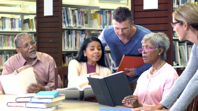 continuing education class in library - mixed age range stock videos & royalty-free footage