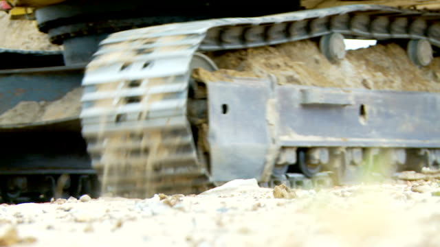 cu continuous track of dozer on contruction site, cape town, south africa - bulldozer stock videos and b-roll footage
