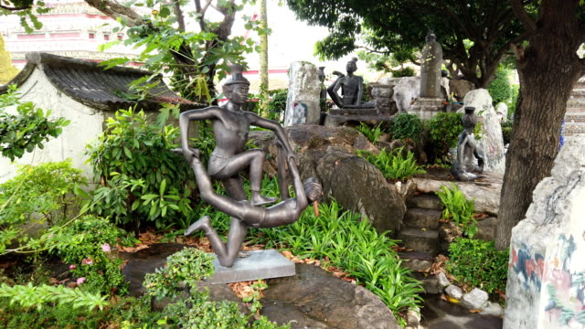 contorting hermits figurines depicting yoga postures in wat pho temple, bangkok - thai culture stock videos & royalty-free footage