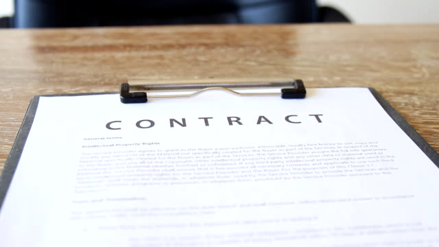 contract on office table waiting for signing
