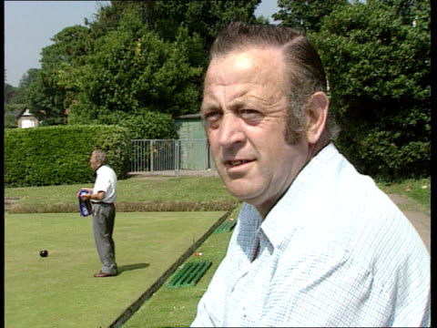 Workers' rights ITN ENGLAND Eastbourne MS Woman playing bowls MS Ball along MS Bowls players along PULL CBV Brian Smeath watching bowls match CMS...