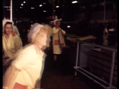 workers' rights itn lib cms jim callaghan wearing white coat hat chatting women workers in factory ms women working in factory cms side callaghan... - contracting stock videos & royalty-free footage