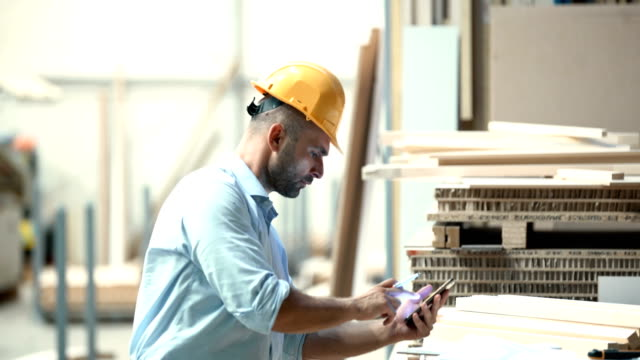 contractor calculating business figures. - manual worker stock videos & royalty-free footage