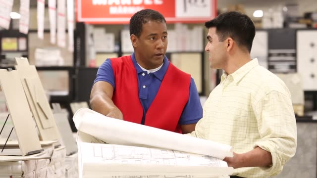 contractor shopping for building materials in home improvement store with salesman - salesman stock videos and b-roll footage
