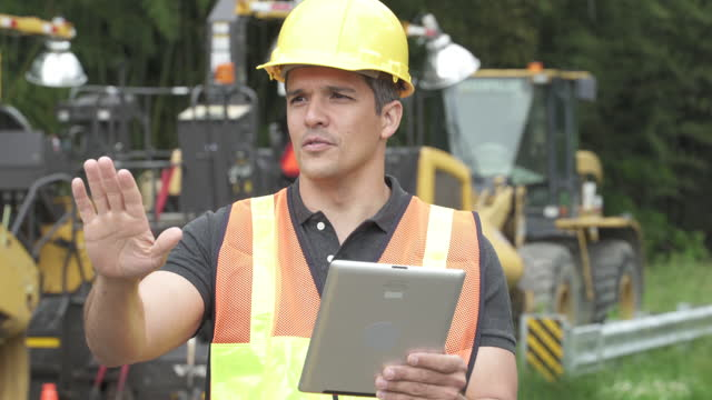 Contractor talking on mobile phone,