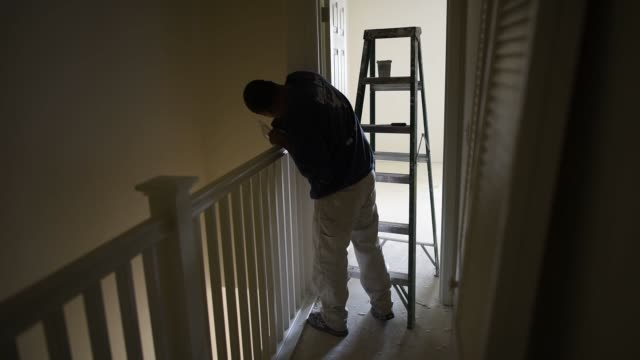 a contractor works on a townhouse under construction in the pepper lane development by pulte homes inc in san jose california us on wednesday april... - fensterbank stock-videos und b-roll-filmmaterial