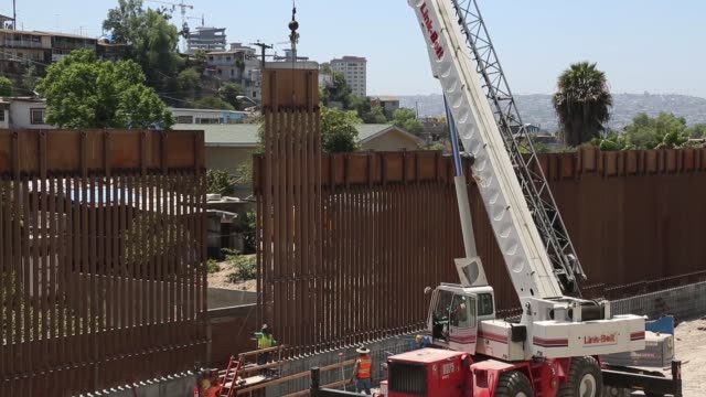 contractors install the final section of the san diego border wall - wall building feature stock videos & royalty-free footage