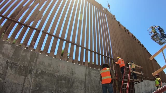 contractors install the final section of the san diego border wall - keep out sign stock videos & royalty-free footage
