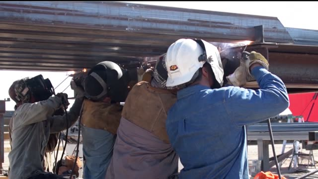 contractors welding panel for new mexican border barrier at phoenix arizona - welding helmet stock videos & royalty-free footage
