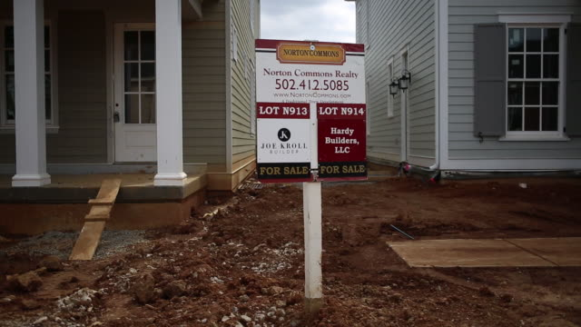 contractors work on a home under construction in the norton commons subdivision of louisville kentucky us on monday march 23 2020 - cement mixer stock videos & royalty-free footage