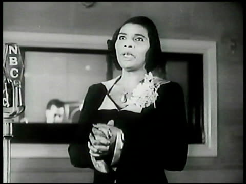 contralto marian anderson singing hymn 'let us break bread together' in recording studio nbc microphone piano bg wwii - nbcuniversal video stock e b–roll