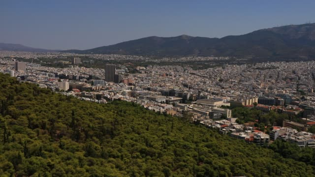 "vídeos y material grabado en eventos de stock de contrast between urban density and nature pictured from the ""lycabettus hill"" viewpoint on august 23, 2020 in athens. during the coronavirus... - athens greece"