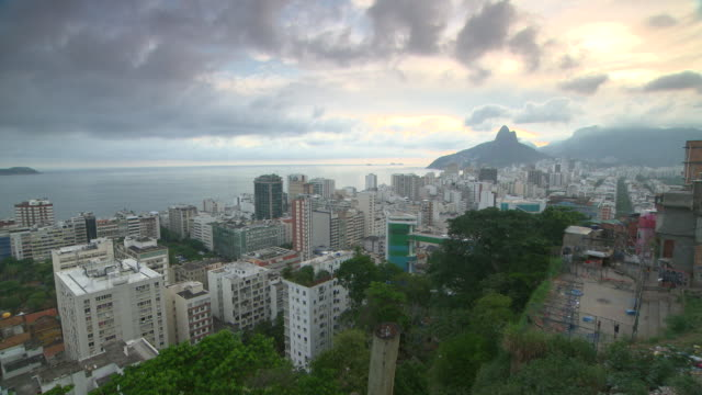 contrast of the beauty and chaos of dwellings and yards in the favela and two brothers hills and ipanema at dusk - contrasts stock videos & royalty-free footage
