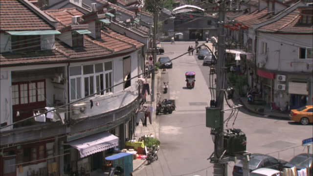 contrasts between old and new buildings shanghai - oriental pearl tower shanghai stock videos & royalty-free footage