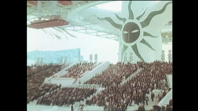 contributor approval required for all uses a digital board displays information for expo 70 in osaka / massive crowd gathers for opening ceremony at... - world's fair stock videos & royalty-free footage