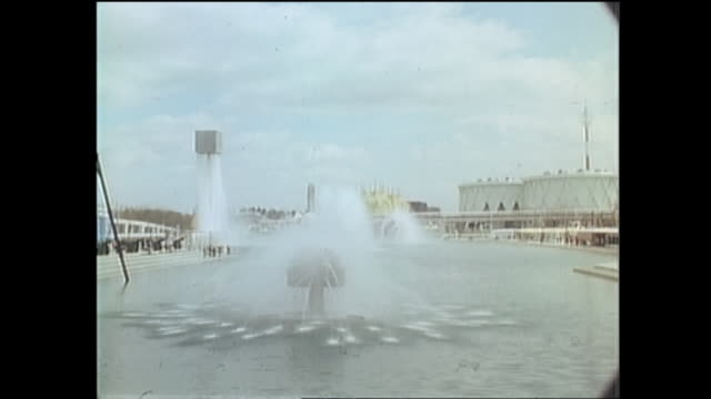 Contributor approval required for all uses A fountain splashes in a pond at Expo 70 in Osaka / The Japan World Exposition 1970 was the first world's...