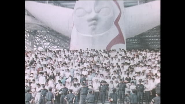 Contributor approval required for all uses Massive crowd follows security guards to walk down the stairs safety / The Japan World Exposition 1970 was...