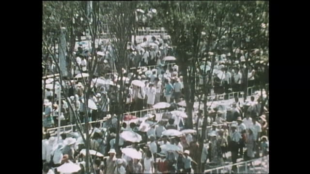 contributor approval required for all uses spectators enter the us pavilion after waiting in line for a long time / the japan world exposition 1970... - pavilion stock videos & royalty-free footage