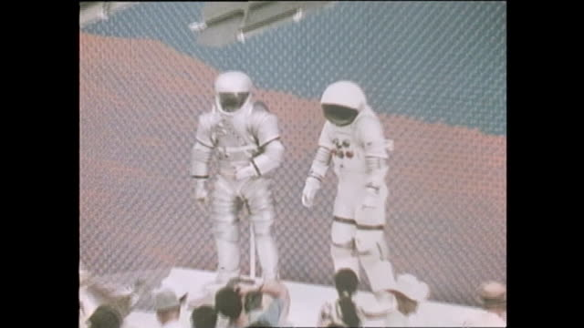 stockvideo's en b-roll-footage met contributor approval required for all uses spectators watch the equipments for space exploration and a moon rock in the us pavilion / the japan world... - de ruimte en astronomie