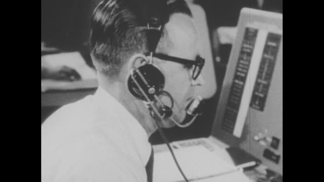 stockvideo's en b-roll-footage met nasa control room at cape canaveral for project mercury / cu computer control boards / cu various engineers / cu christopher kraft the flight... - kraft