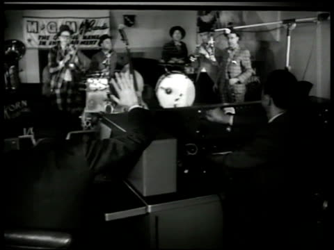 stockvideo's en b-roll-footage met control room men recording studio w/ band 'cut i heard a noise' ms trombone player stan fritts 'that was us' vs control men amp fritts talking bull... - 1949